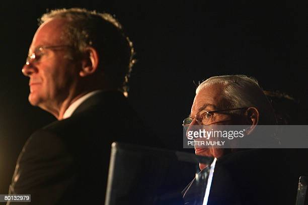 Northern Ireland's first minister Ian Paisley sits with Deputy First Minister Martin McGuiness on March 5 2008 during the celebration of the...