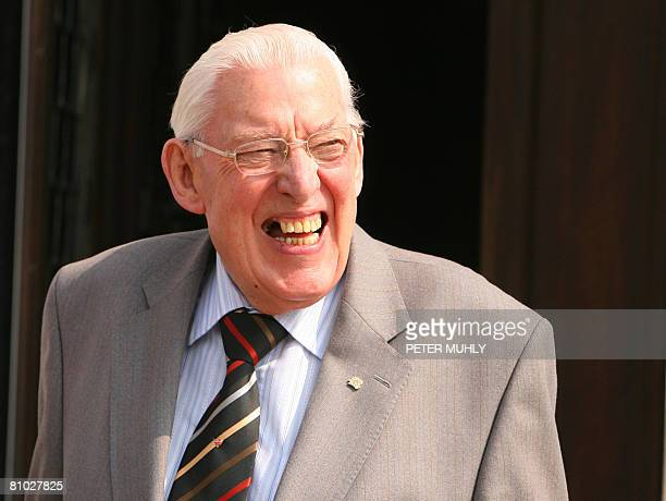 Northern Ireland's First Minister Ian Paisley smiles as he waits for the arrival of British Prime Minister Gordon Brown at Stormont Parliament...