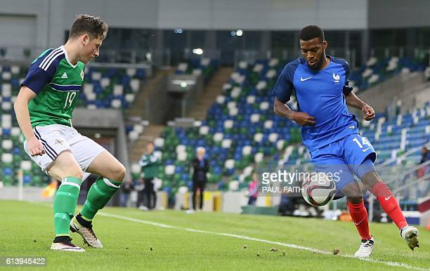 Northern Ireland's forward Conor McDermott vies with France's midfielder Thomas Lemar during the Under21 2017 European Championship qualifier...