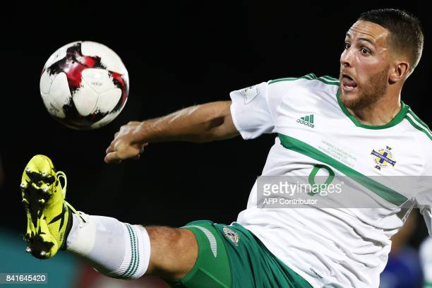 Northern Ireland's forward Conor Washington controls the ball during the 2018 FIFA World Cup qualifying football match San Marino vs Northern Ireland...