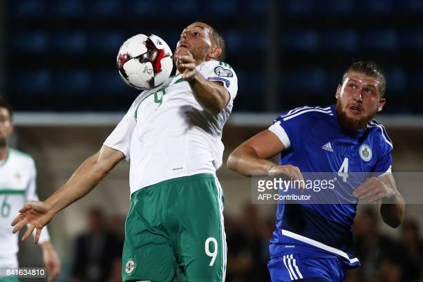 Northern Ireland's forward Conor Washington fights for the ball with San Marino's defender Juri Biordi during the 2018 FIFA World Cup qualifying...