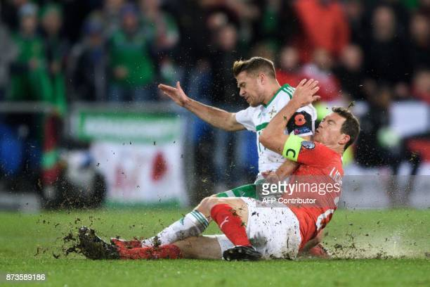 TOPSHOT Northern Ireland's forward Jamie Ward and Swiss midfielder Stephan Lichtsteiner vie for the ball during the FIFA 2018 World Cup playoff...