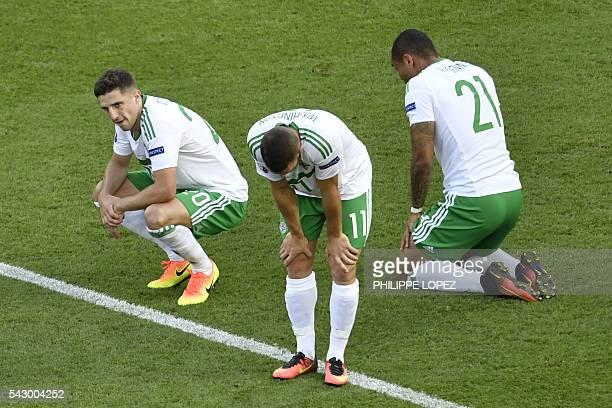 TOPSHOT Northern Ireland's forward Josh Magennis Northern Ireland's forward Conor Washington and Northern Ireland's defender Craig Cathcart are...