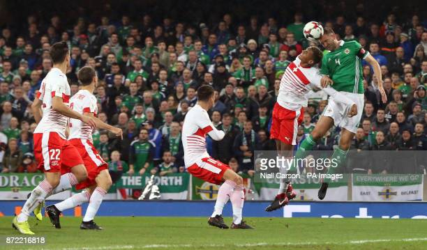 Northern Ireland's Gareth McAuley and Switzerland's Manuel Akanji battle for the ball during the 2018 World Cup Qualifying PlayOff First Leg match at...