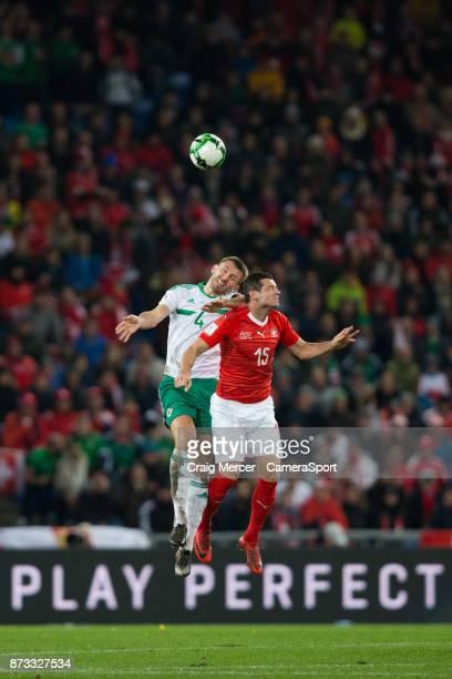 Northern Irelands Gareth McAuley battles for possession with Switzerlands Blerim Dzemaili during the FIFA 2018 World Cup Qualifier PlayOff Second Leg...