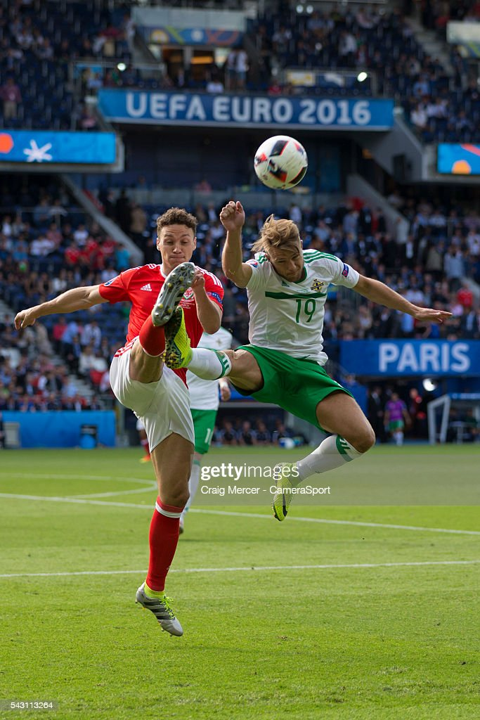 Northern Ireland's Jamie Ward battles for possession with Wales's James Chester during the UEFA Euro 2016 Round of 16 match between Wales and Northern Ireland at Parc des Princes on June 25 in Paris, France.
