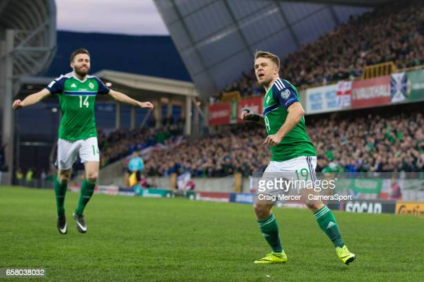 Northern Ireland's Jamie Ward celebrates scoring the opening goal during the FIFA 2018 World Cup Qualifier between Northern Ireland and Norway at...