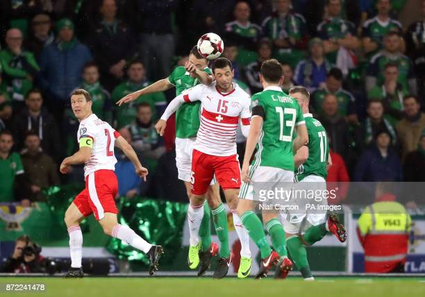 Northern Ireland's Jonny Evans and Switzerland's Blerim Dzemaili battle for the ball during the 2018 World Cup Qualifying PlayOff First Leg match at...