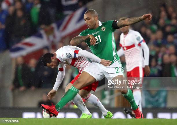 Northern Ireland's Josh Magennis and Switzerland's Blerim Dzemaili battle for the ball during the 2018 World Cup Qualifying PlayOff First Leg match...