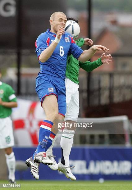 Northern Ireland's Keith Gillespie clashes with Iceland's Hannes Thorstein Sigurdsson during the European Championship qualifying match at Windsor...