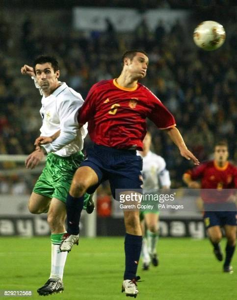 Northern Ireland's Keith Gillespie is beaten to the ball by Spain's Puyol during their European Championship Qualifying Group 6 match at the Carles...
