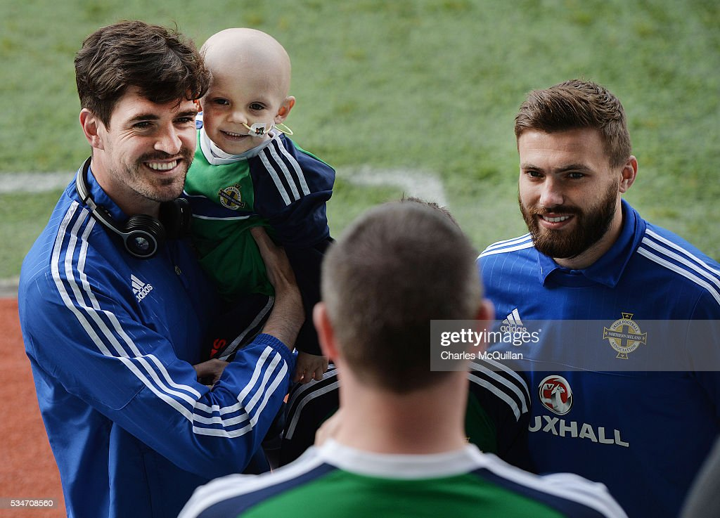 Northern Ireland's Kyle Lafferty (L) and Stuart Dallas (R) pose with fans before the international friendly game between Northern Ireland and Belarus on May 26, 2016 in Belfast, Northern Ireland.