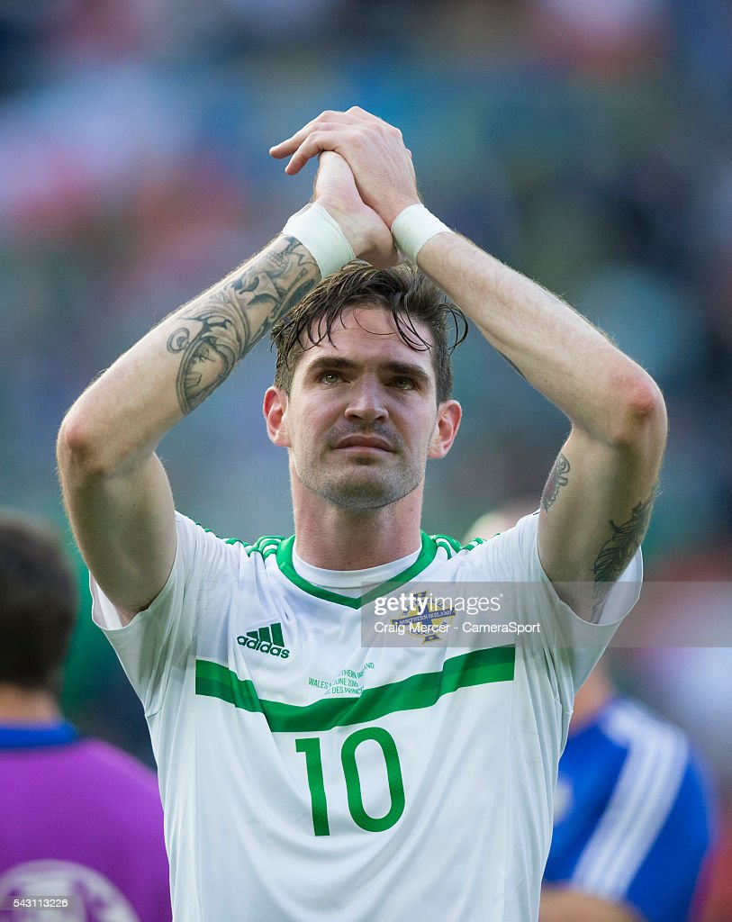 Northern Ireland's Kyle Lafferty applauds the fans at full time during the UEFA Euro 2016 Round of 16 match between Wales and Northern Ireland at Parc des Princes on June 25 in Paris, France.