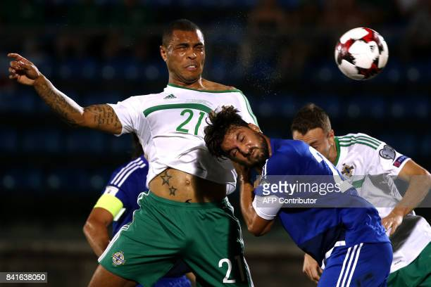 Northern Ireland's midfielder Josh Magennis fights for the ball with San Marino's goalkeeper Mirko Palazzi during the 2018 FIFA World Cup qualifying...