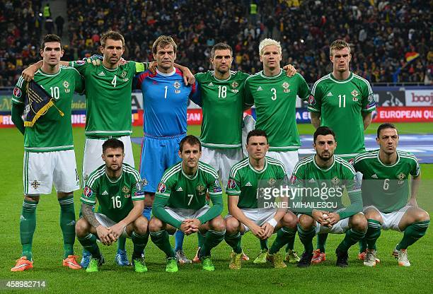 Northern Ireland's national team poses for a group photo prior to the UEFA 2016 European Championship qualifying round Group F football match Romania...