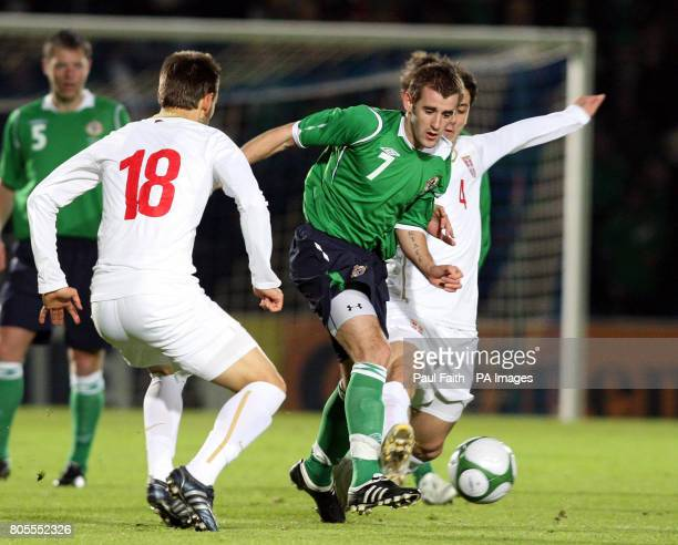 Northern Ireland's Niall McGinn tussles with Serbia's Milos Ninkovic and Gojko Kacar during the International Friendly at Windsor Park Belfast