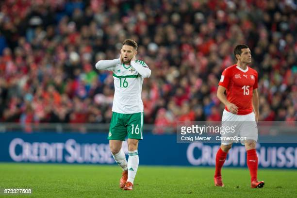 Northern Ireland's Oliver Norwood reacts after an early missed chance during the FIFA 2018 World Cup Qualifier PlayOff Second Leg between Switzerland...