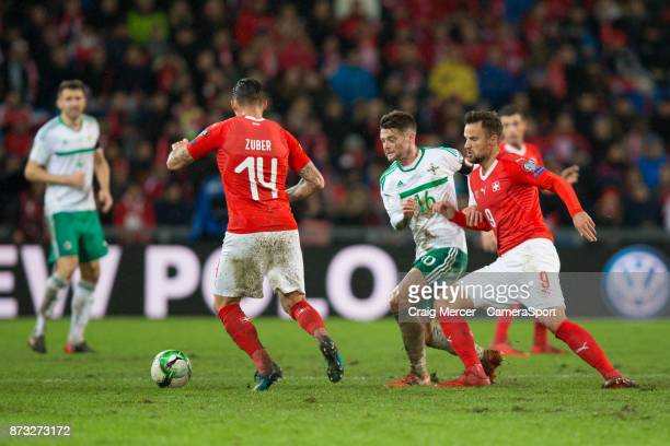 Northern Ireland's Oliver Norwood vies for possession with Switzerlands Haris Seferovic and Switzerlands Steven Zuber during the FIFA 2018 World Cup...