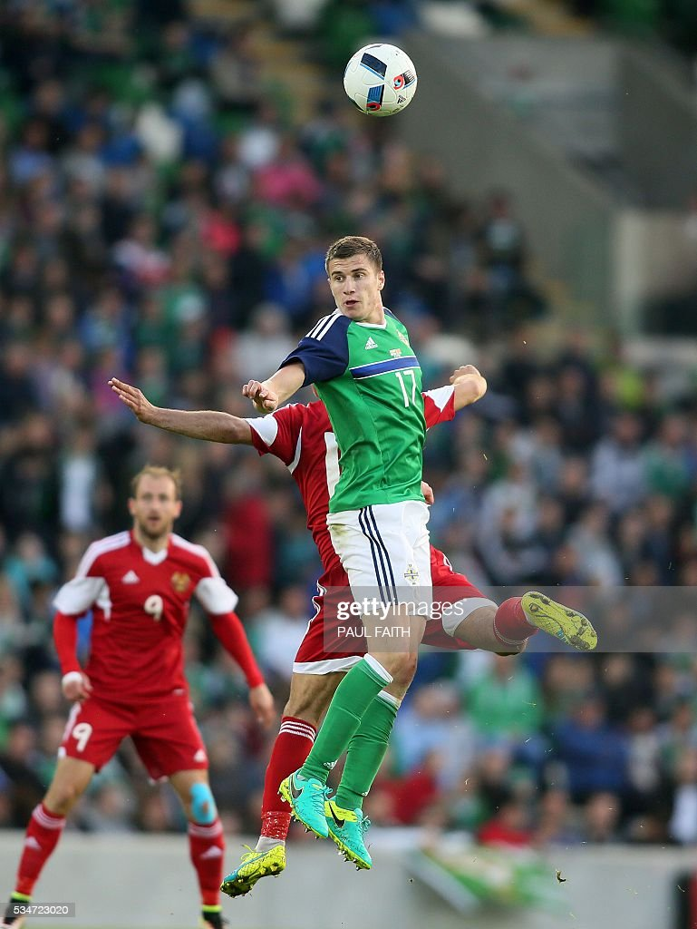 Northern Ireland's Paddy McNair (front) vies with Belarus' player during an international friendly football match between Northern Ireland and Belarus at Windsor Park in Belfast, Northern Ireland, on May 27, 2016. / AFP / PAUL