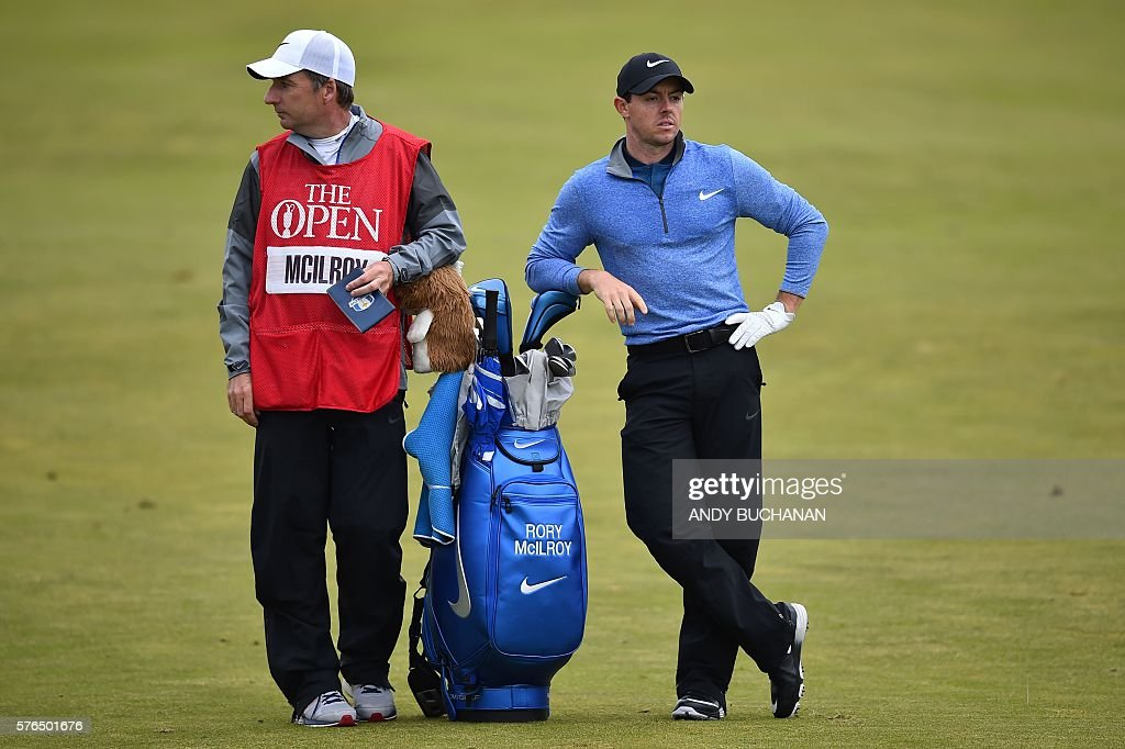 Northern Ireland's Rory McIlroy and caddie JP Fitzgerald wait on the 10th fairway during his second round on day two of the 2016 British Open Golf...