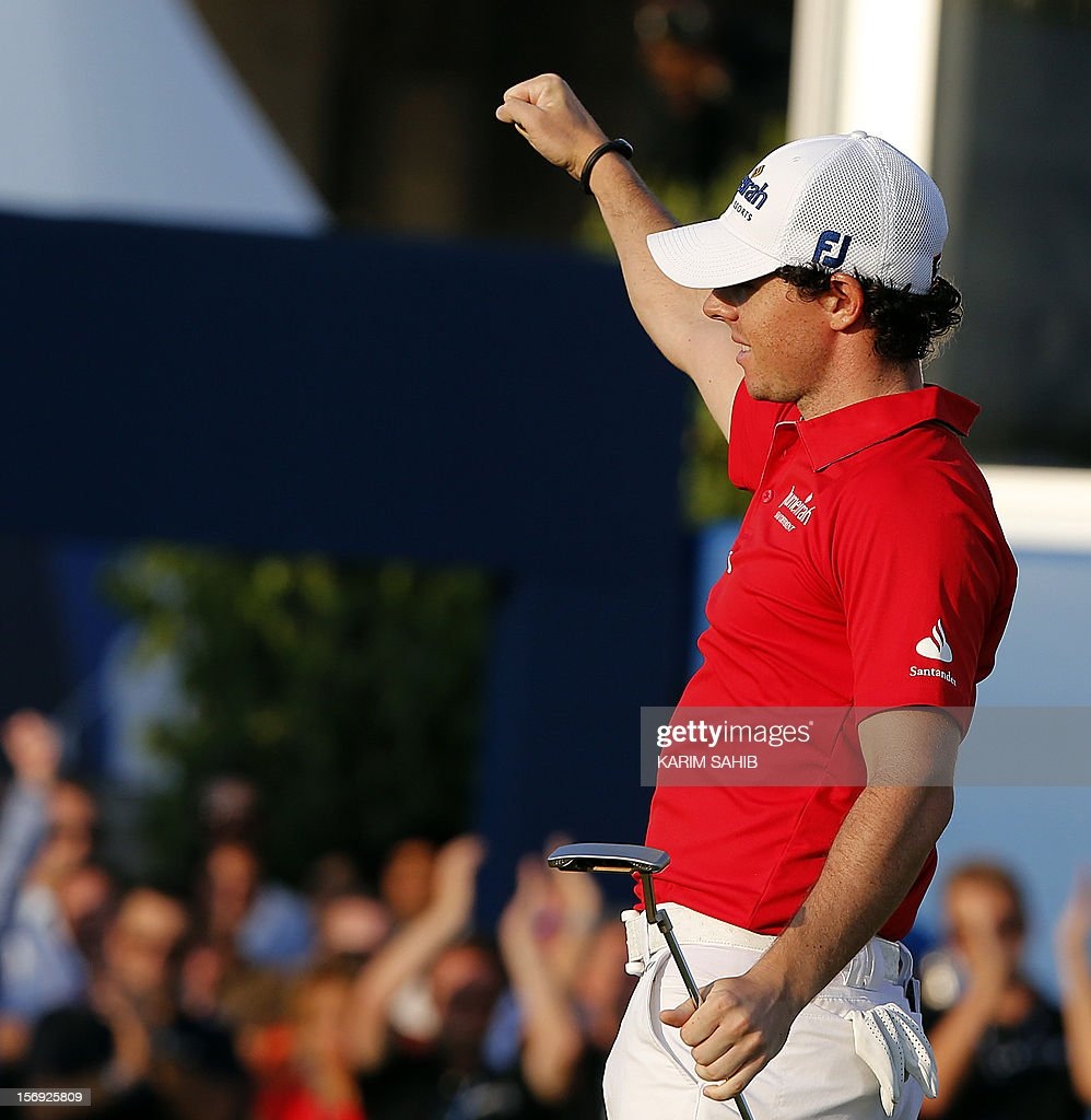 Northern Ireland's Rory McIlroy celebrates as he wins the DP World Tour golf Championship in the Gulf emirate of Dubai on November 25, 2012. McIlroy responded in magnificent fashion to Justin Rose's course record round of 10-under par 62 by making five birdies in his last five holes to win the Championships. AFP PHOTO / KARIM SAHIB