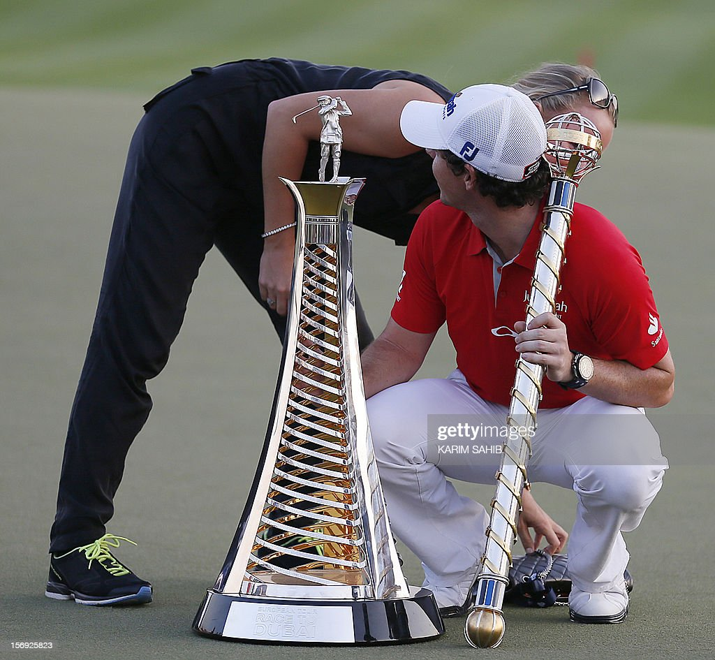Northern Ireland's Rory McIlroy is kissed by his girlfriend, Denmark's tennis champion Caroline Wozniacki, after winning the DP World Tour golf Championship in the Gulf emirate of Dubai on November 25, 2012. McIlroy responded in magnificent fashion to Justin Rose's course record round of 10-under par 62 by making five birdies in his last five holes to win the Championships.