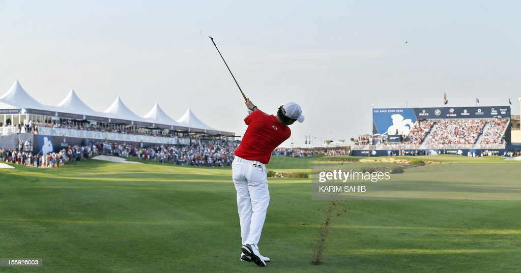 Northern Ireland's Rory McIlroy plays a shot during the DP World Tour golf Championship in the Gulf emirate of Dubai on November 25, 2012. McIlroy responded in magnificent fashion to Justin Rose's course record round of 10-under par 62 by making five birdies in his last five holes to win the Championships.