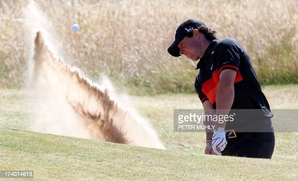 Northern Ireland's Rory McIlroy plays a shot out of a bunker on the third during the second round of the 2013 British Open Golf Championship at...