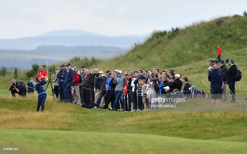 Northern Ireland's Rory McIlroy plays from the rough on the 13th hole during practice on July 12 ahead of the 2016 British Open Golf Championship at...