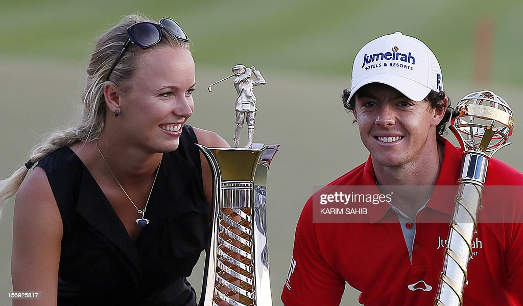 Northern Ireland's Rory McIlroy poses with his girlfriend, Denmark's tennis champion Caroline Wozniacki, after winning the DP World Tour golf Championship in the Gulf emirate of Dubai on November 25, 2012. McIlroy responded in magnificent fashion to Justin Rose's course record round of 10-under par 62 by making five birdies in his last five holes to win the Championships.