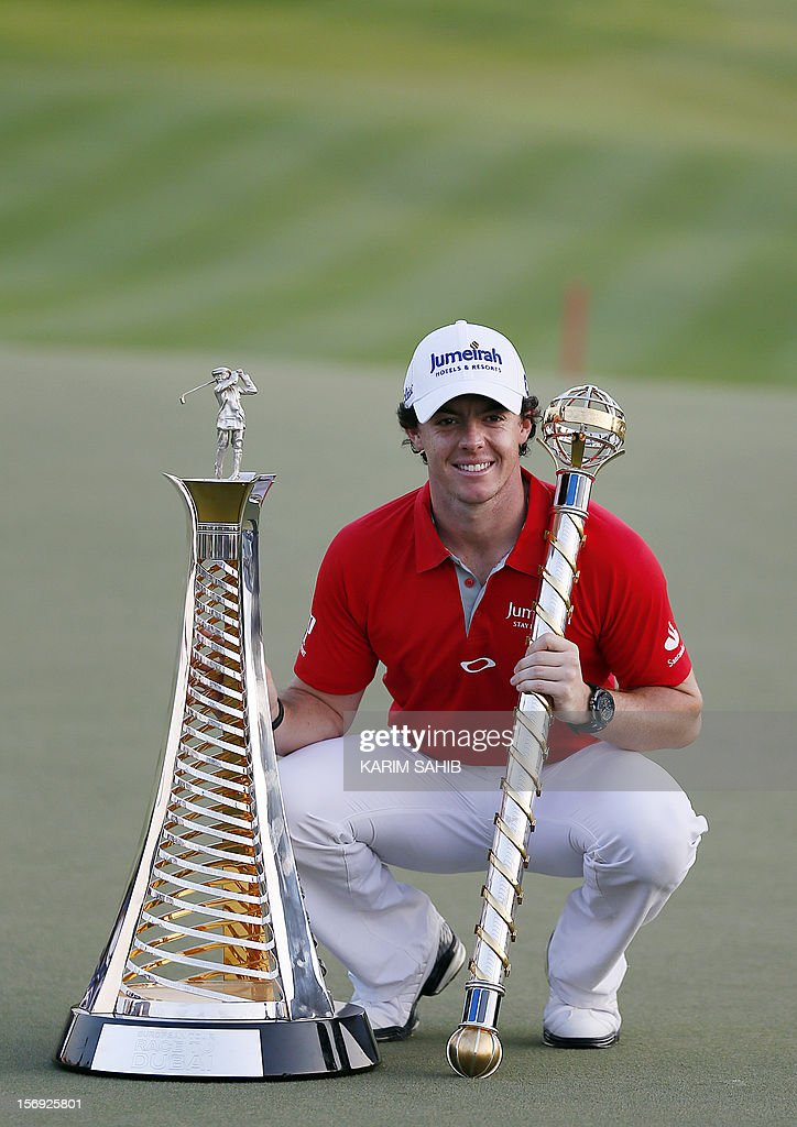 Northern Ireland's Rory McIlroy poses with his trophy after winning the DP World Tour golf Championship in the Gulf emirate of Dubai on November 25, 2012. McIlroy responded in magnificent fashion to Justin Rose's course record round of 10-under par 62 by making five birdies in his last five holes to win the Championships.
