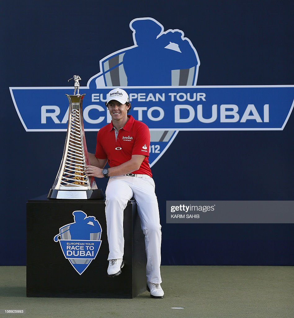 Northern Ireland's Rory McIlroy poses with his trophy after winning the DP World Tour golf Championship in the Gulf emirate of Dubai on November 25, 2012. McIlroy responded in magnificent fashion to Justin Rose's course record round of 10-under par 62 by making five birdies in his last five holes to win the Championships. AFP PHOTO / KARIM SAHIB