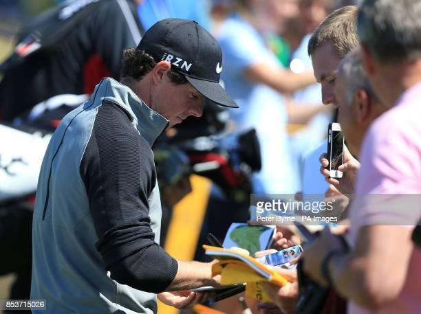 Northern Ireland's Rory McIlroy signs autographs during practice day three of the 2014 Open Championship at Royal Liverpool Golf Club Hoylake
