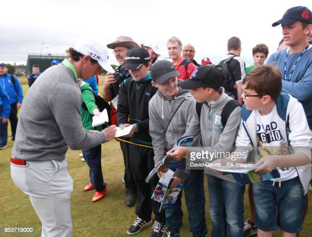 Northern Ireland's Rory McIlroy signs autographs for young fans during practice day four of the 2014 Open Championship at Royal Liverpool Golf Club...