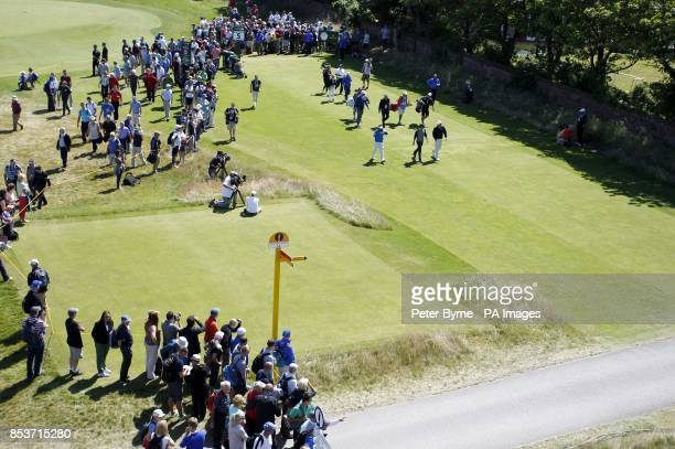 Northern Ireland's Rory McIlroy USA's Brooks Koepka and Thailand's Thongchai Jaidee during practice day three of the 2014 Open Championship at Royal...