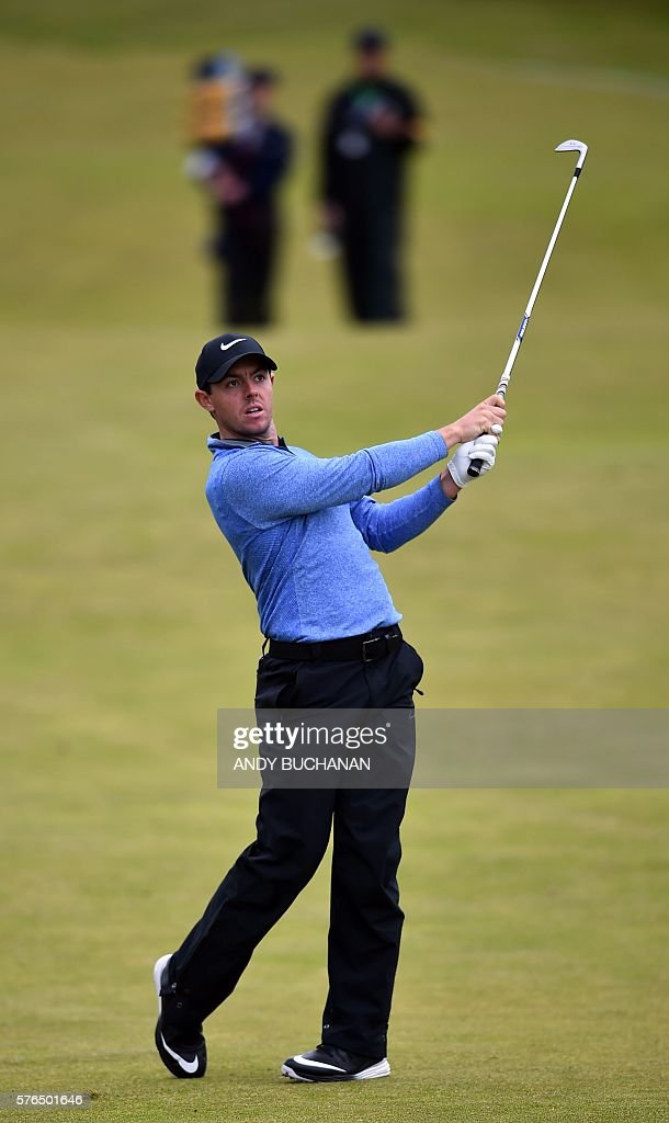 Northern Ireland's Rory McIlroy watches his iron shot from the 10th fairway during his second round on day two of the 2016 British Open Golf...