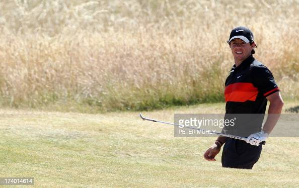 Northern Ireland's Rory McIlroy watches his shot out of a bunker on the third during the second round of the 2013 British Open Golf Championship at...