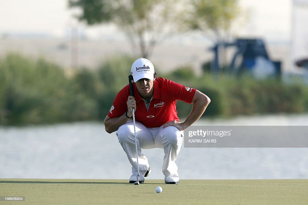Northern Ireland's Rory McIlroy watches the ball during 4rd round of the DP World Tour Championship in the Gulf emirate of Dubai, on November 25, 2012. McIlroy responded in magnificent fashion to Justin Rose's course record round of 10-under par 62 by making five birdies in his last five holes to win the Championships.