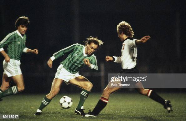 Northern Ireland's Sammy McIlroy is challenged by Austria's Martin Gisinger during the European Championship Qualiyfing match at Windsor Park in...