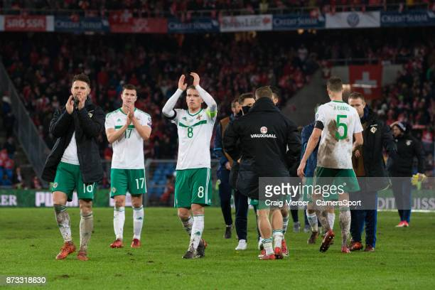 Northern Ireland's Steven Davis and Oliver Norwood applauds the fans at the final whistle during the FIFA 2018 World Cup Qualifier PlayOff Second Leg...