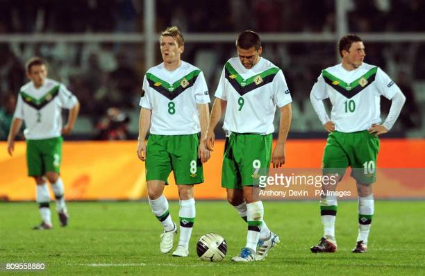Northern Ireland's Steven Davis David Healy and Corry Evans appear dejected following Italy's opening goal scored by Antonio Cassano during UEFA Euro...