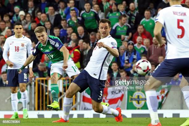 Northern Ireland's striker Jamie Ward scores the opening goal of the World Cup 2018 qualification football match between Northern Ireland and Norway...