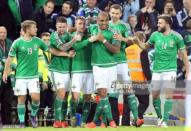 Northern Ireland's striker Josh Magennis celebrates after he scored during the UEFA Euro 2016 qualifying Group F football match between Northern...