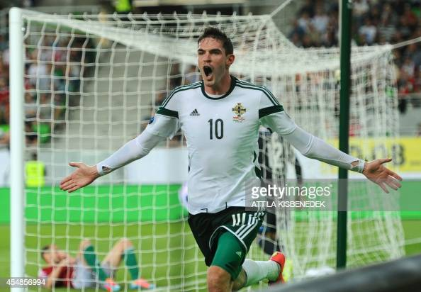 Northern Ireland's striker Kyle Lafferty celebrates after scoring during the UEFA Euro 2016 Group F qualifying match of Hungary vs Northern Ireland...