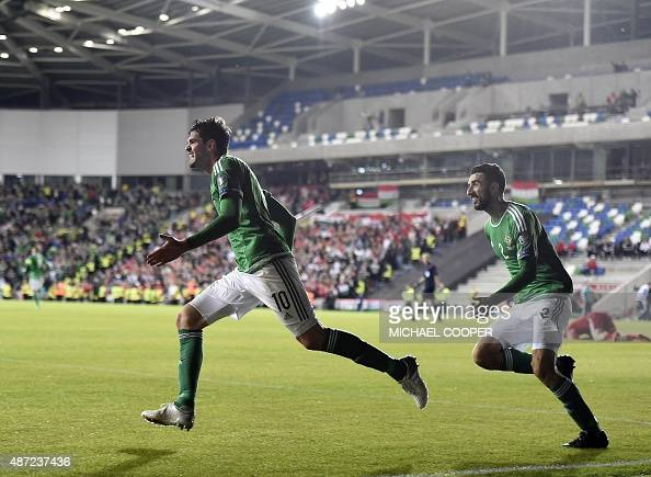 Northern Ireland's striker Kyle Lafferty celebrates with Northern Ireland's striker Conor McLaughlin after scoring their late equaliser during the...
