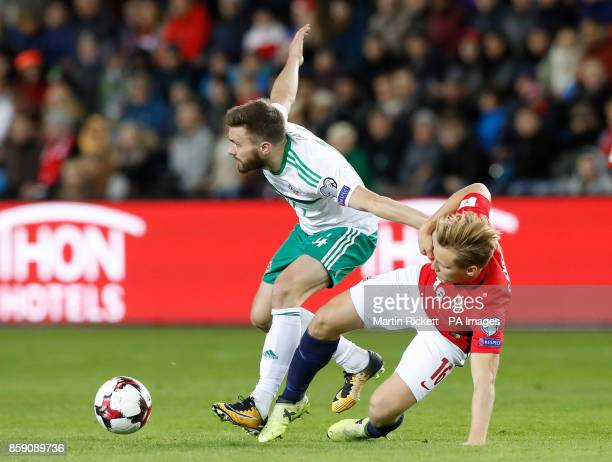 Northern Ireland's Stuart Dallas and Norway's Jonas Svensson battle for the ball during the 2018 FIFA World Cup Qualifying Group C match at the...