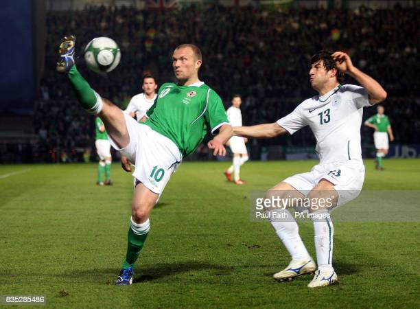 Northern Ireland's Warren Feeney battles with Slovenia's Bojan Jokic during the World Cup Qualifying match at Windsor Park Belfast