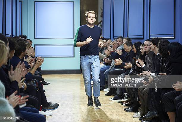 Northern Irish designer JW Anderson greets the crowd after his catwalk show on the third day of the Autumn/Winter 2017 London Fashion Week Men's...