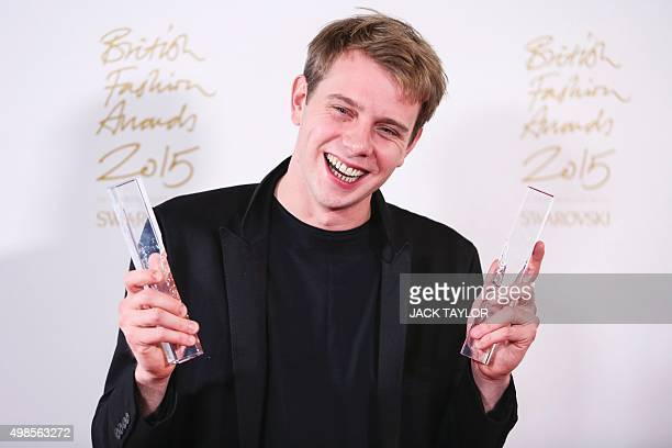 Northern Irish fashion designer JWAnderson poses for pictures with his 'Menswear Designer' and 'Womenswear Designer' awards during the British...