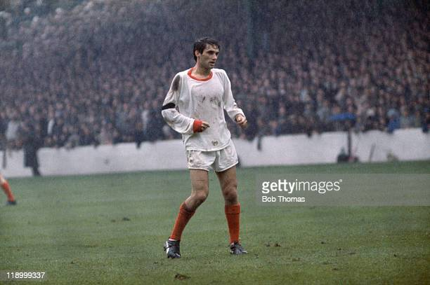 Northern Irish footballer George Best on the field for Manchester United during a match against Burnley circa 1963